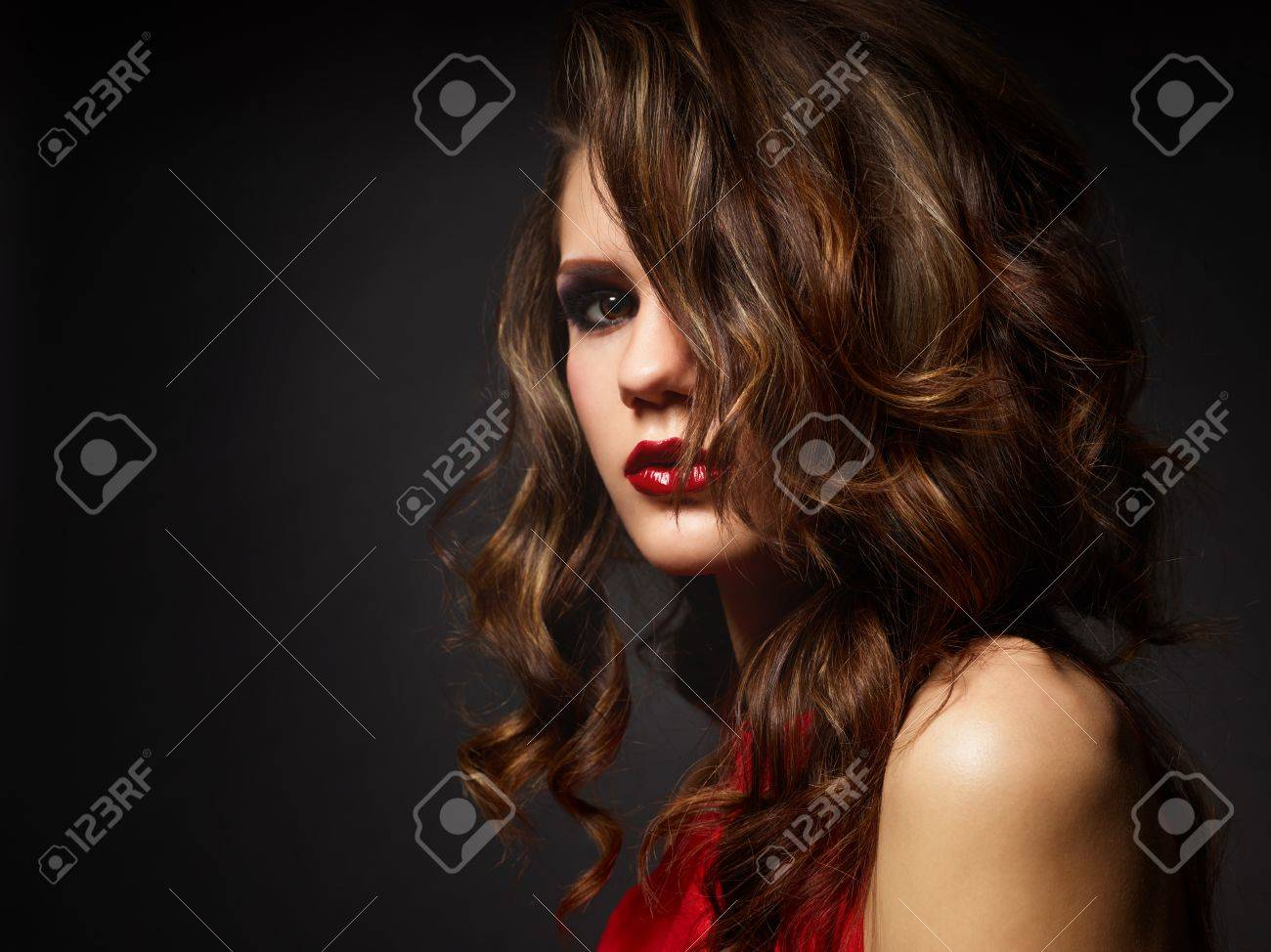 Closeup portrait of young seductive woman in a red dress Stock Photo - 13401603
