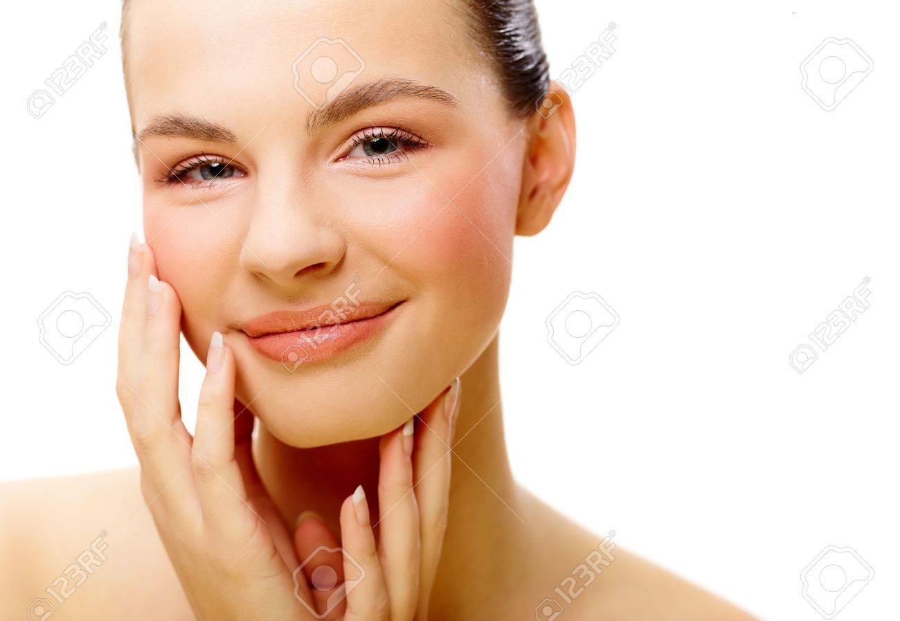 Young attractive woman face over isolated white background Stock Photo - 17159287