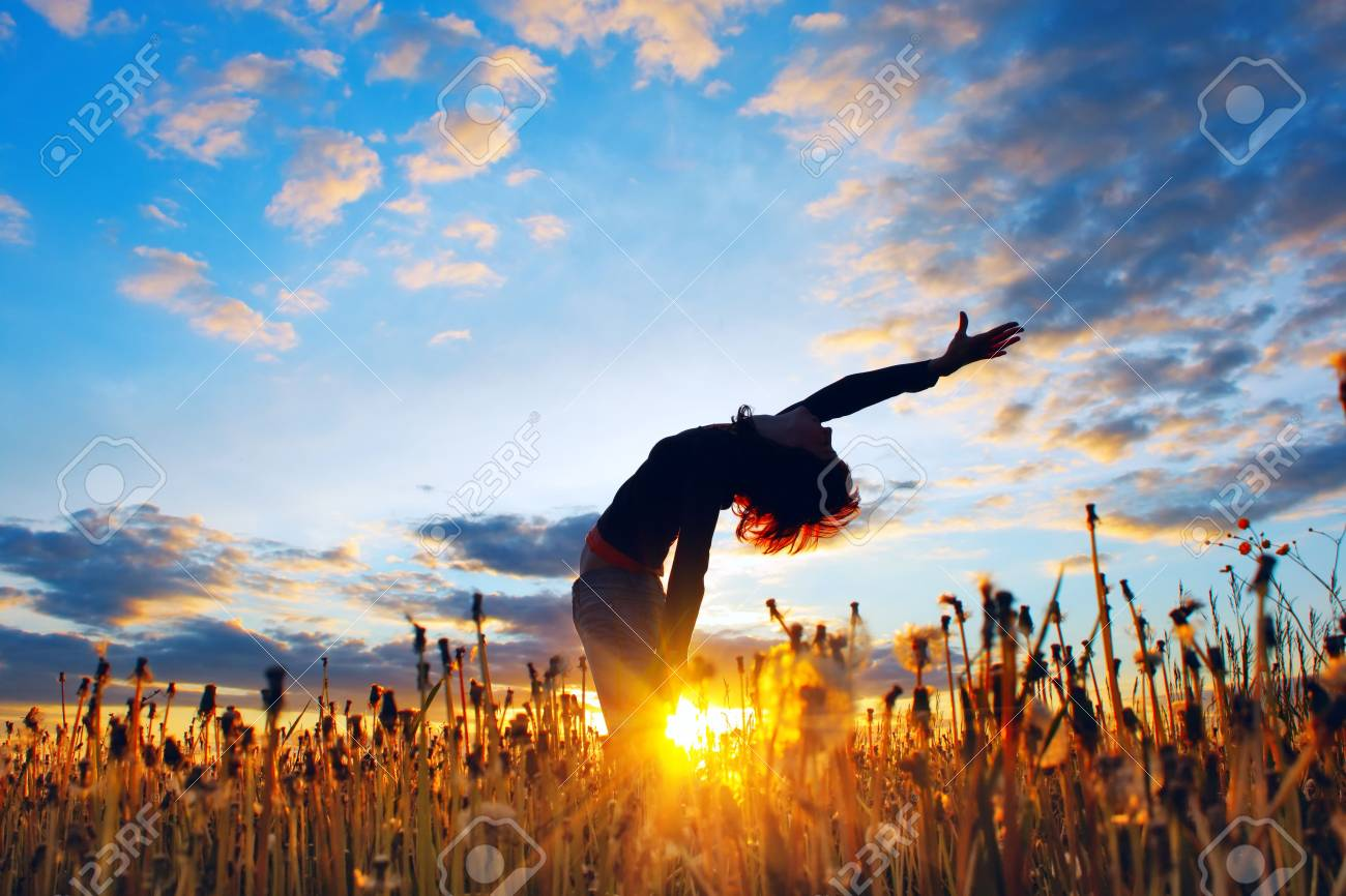 Young woman under sunset light in meadow with herbs Stock Photo - 5742867