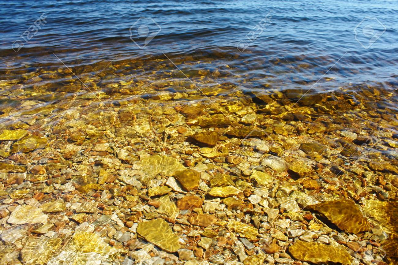 Water surface with yellow stones Stock Photo - 5782584