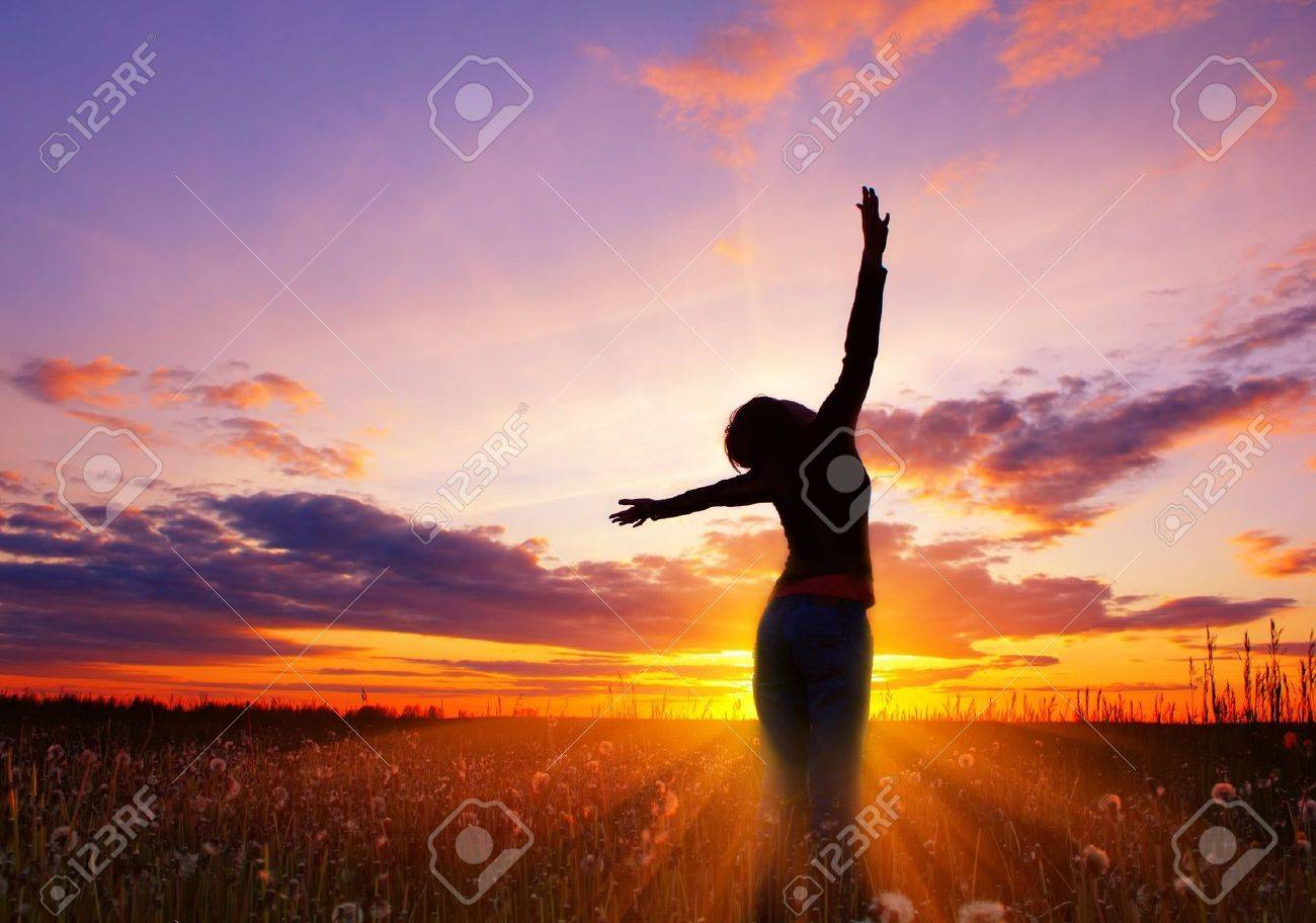 Young woman's silhouette over pink sunset light Stock Photo - 5964577