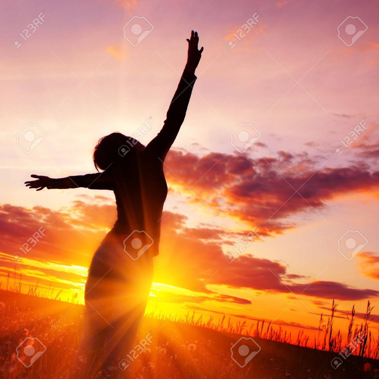 Young woman's silhouette over pink sunset light Stock Photo - 5964581