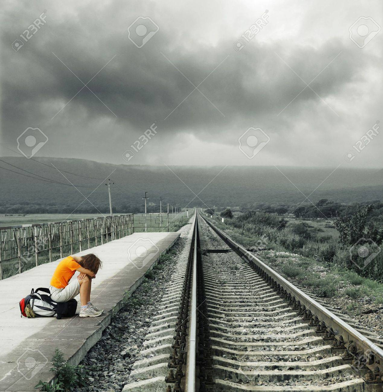 Young woman waiting train on station Stock Photo - 7297229