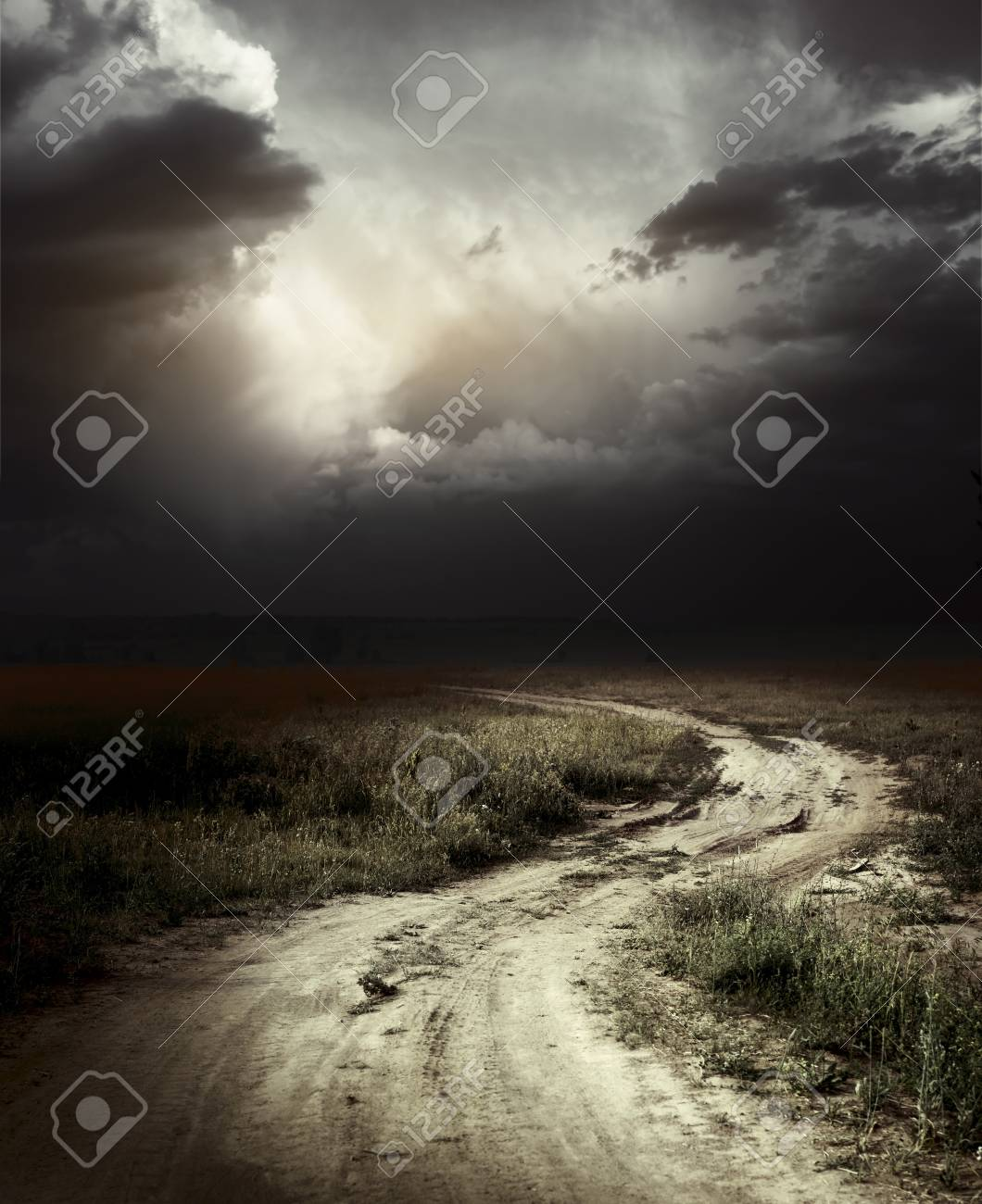 Rural road and dark storm clouds Stock Photo - 7470133