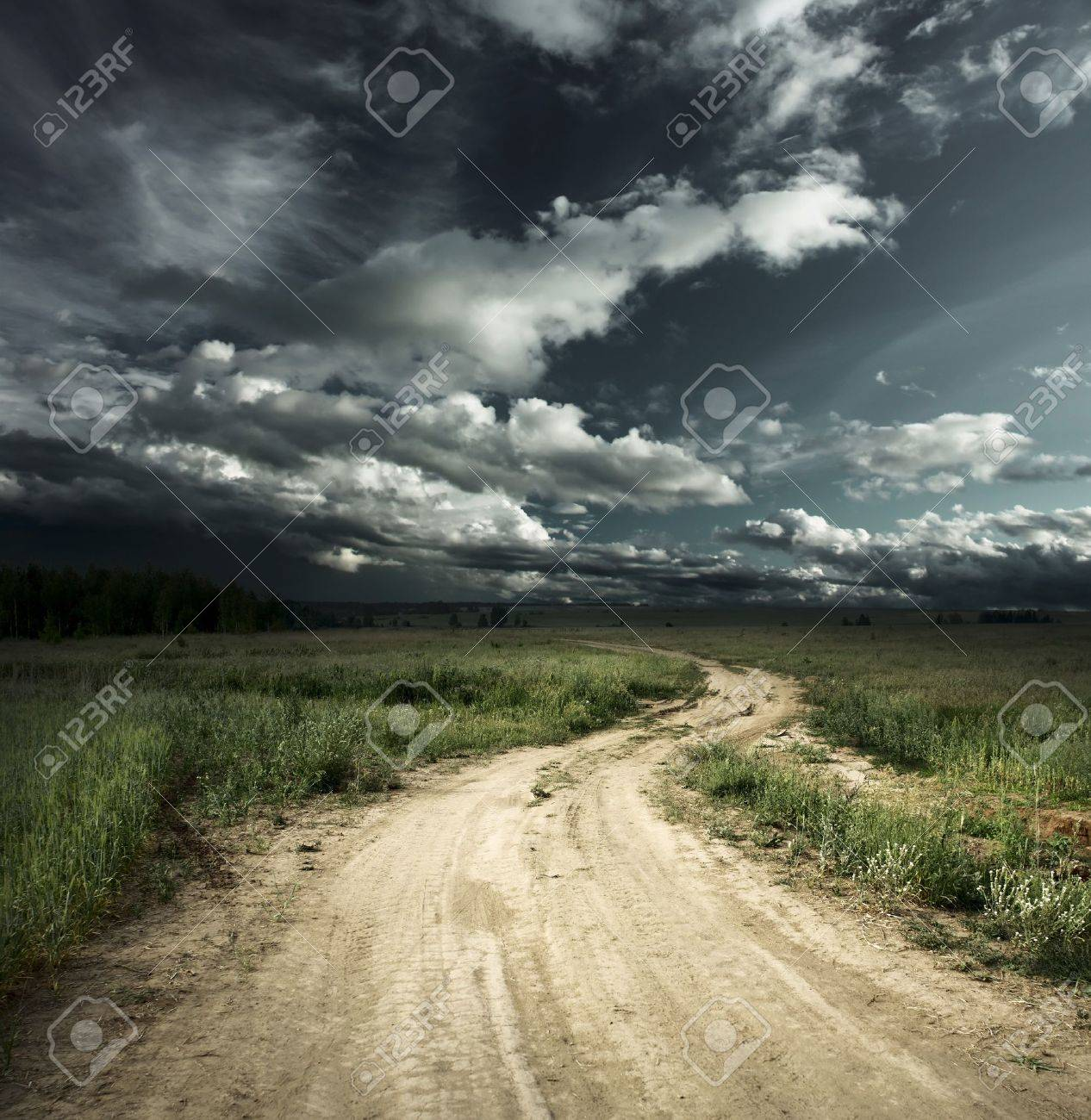 Road in field and stormy clouds Stock Photo - 7470124