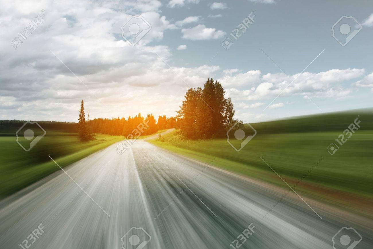Asphalt blurry road on rural landscape Stock Photo - 7600072