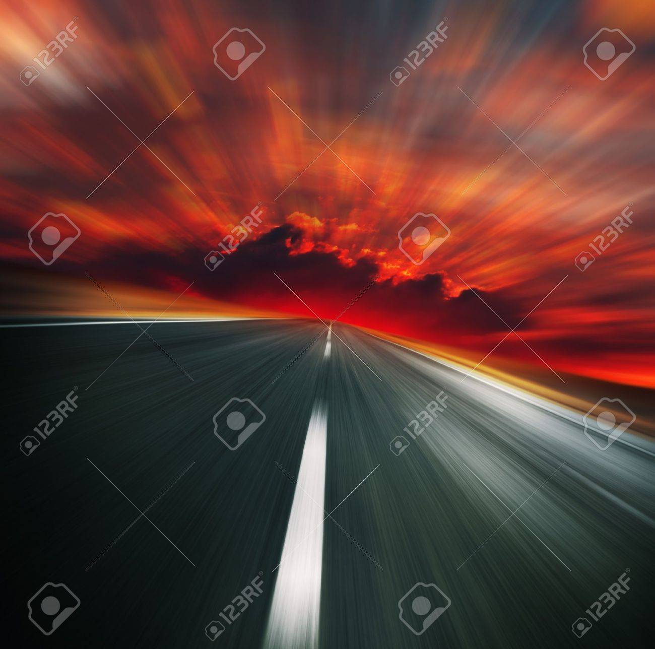 Blurred asphalt road and red bloody blurred sky Stock Photo - 7600095