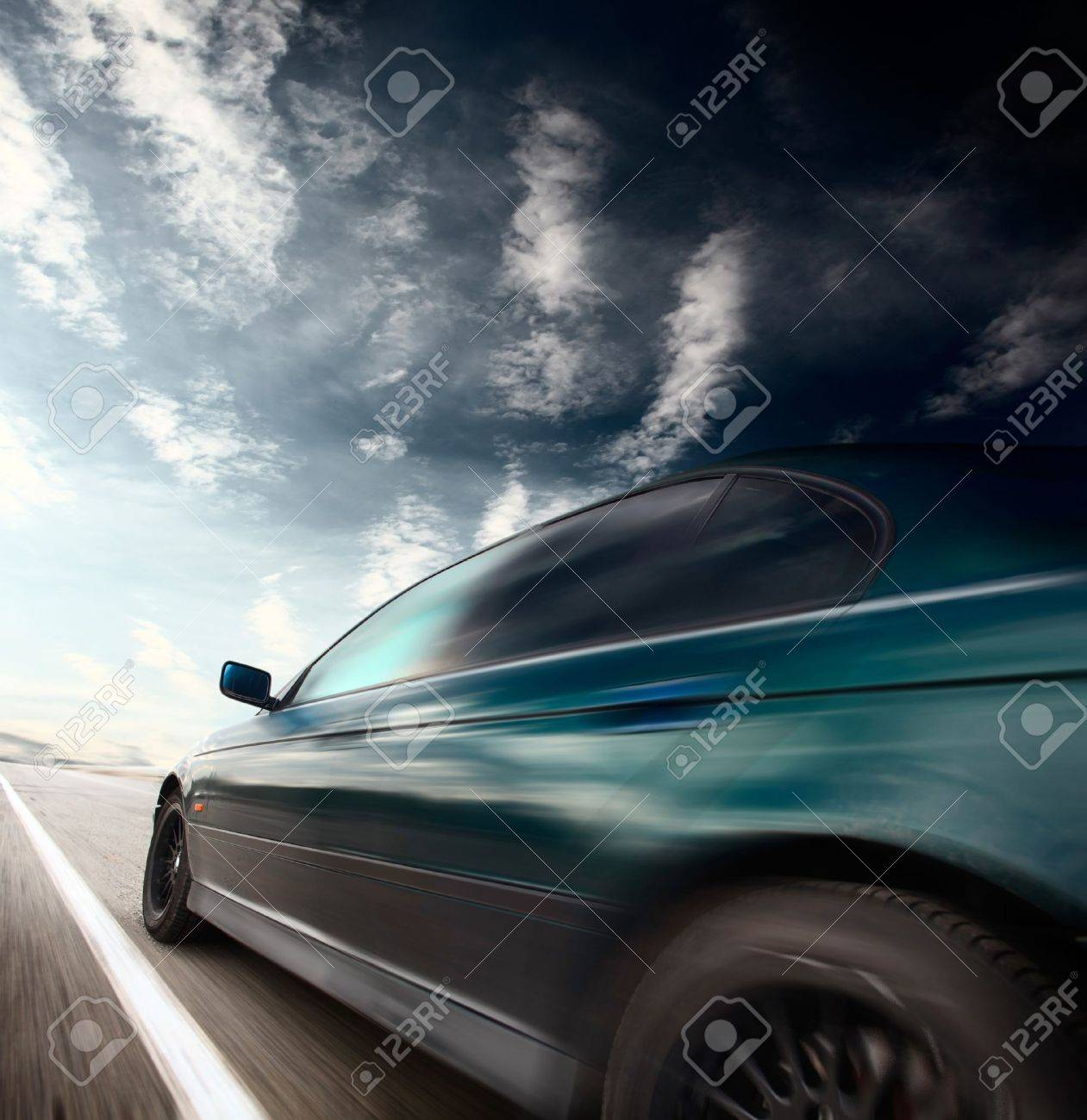 Motion blurred car on asphalt road and sky with clouds Stock Photo - 7791417