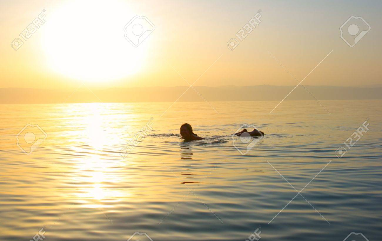 Young woman swimming in the Dead sea Stock Photo - 8581027