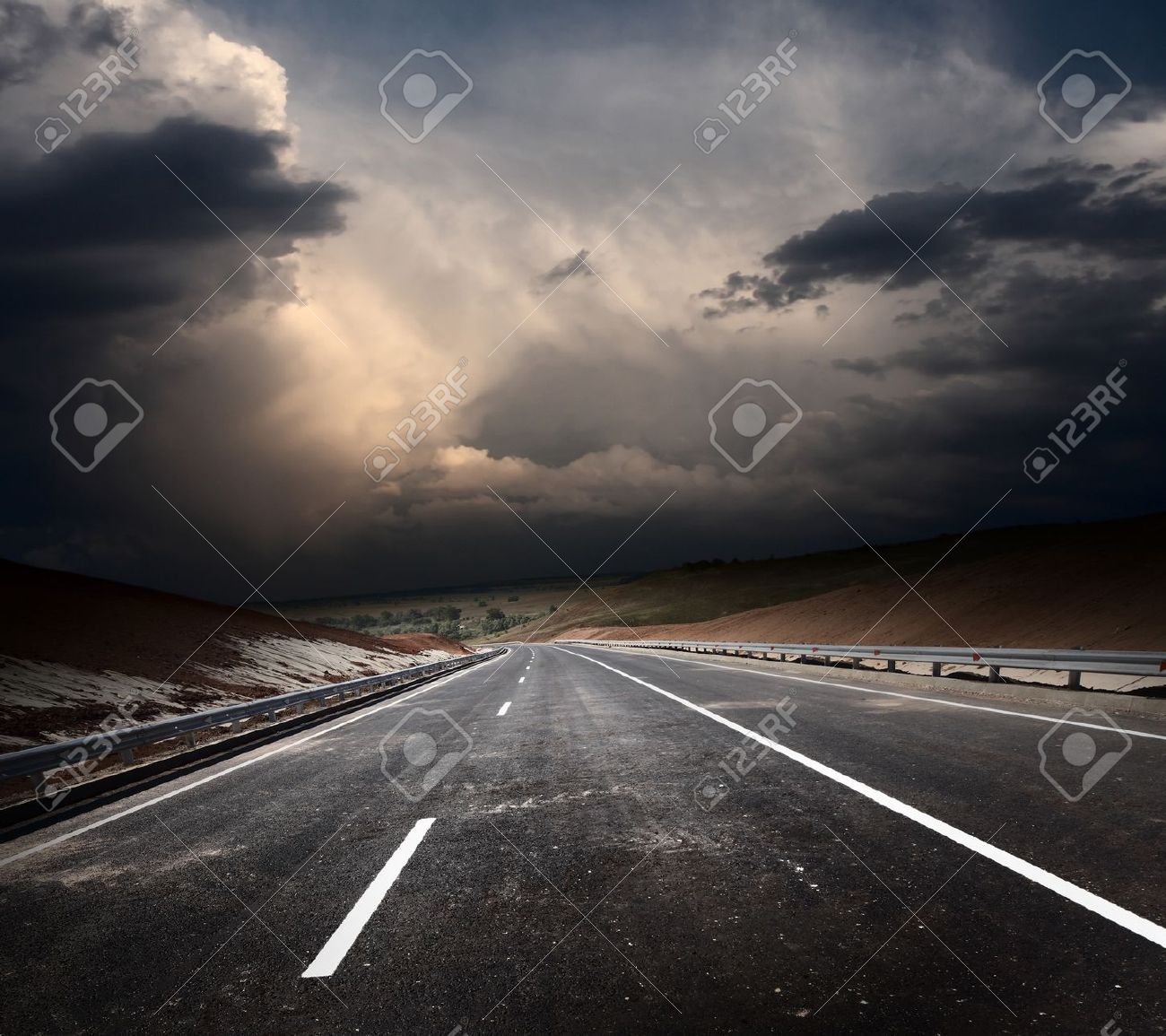 Dirty asphalt road and dark thunder clouds Stock Photo - 10676117