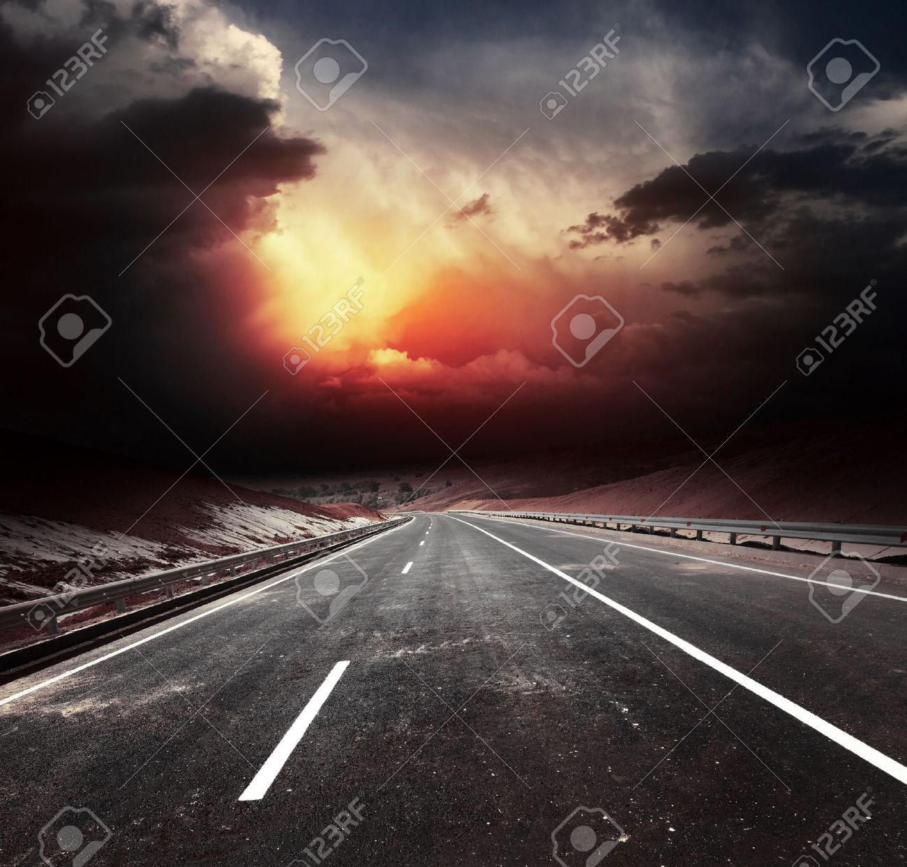 Dirty asphalt road and dark thunder clouds Stock Photo - 11540932