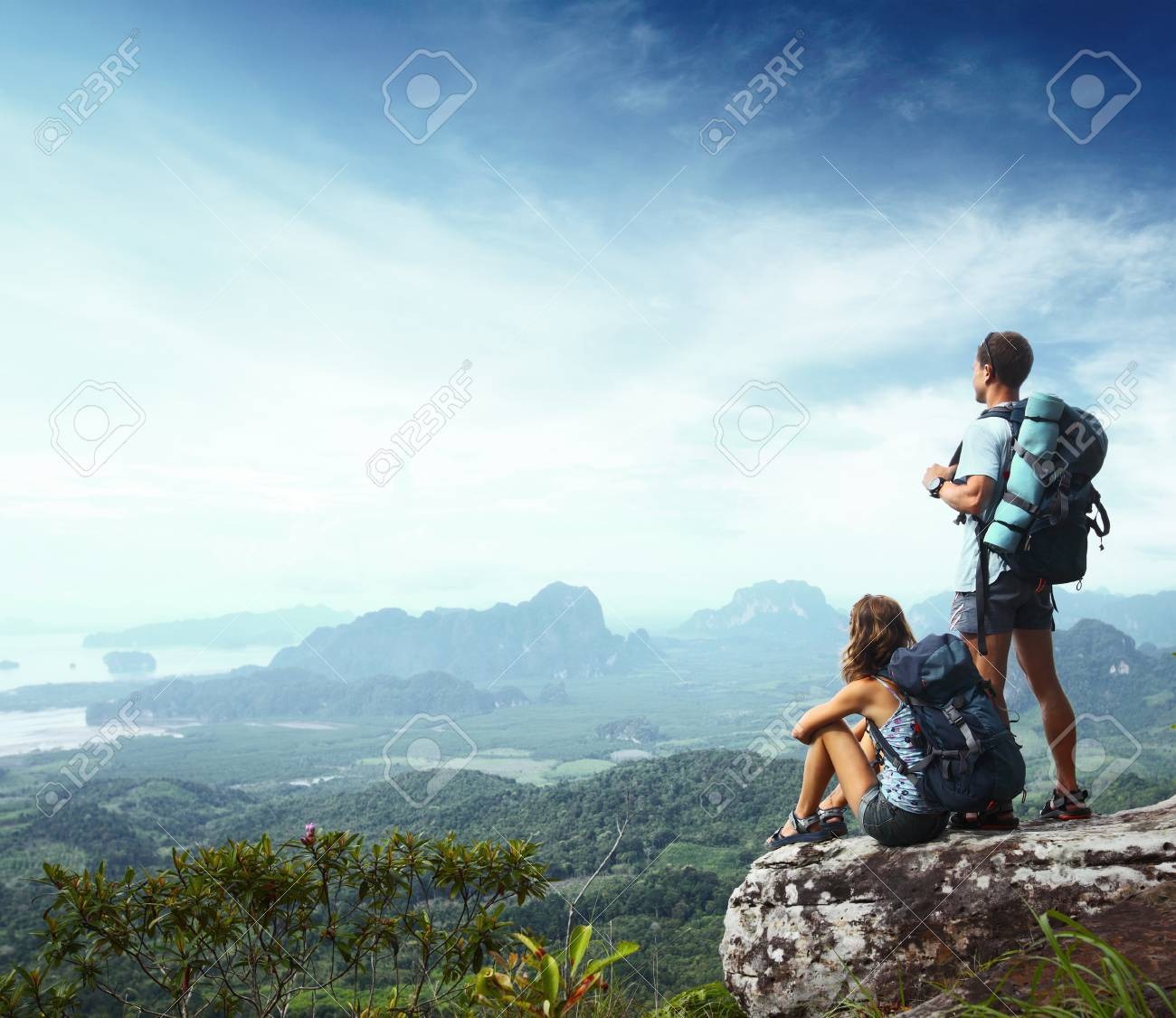 Young backpackers enjoying a valley view from top of a mountain Stock Photo - 16840882