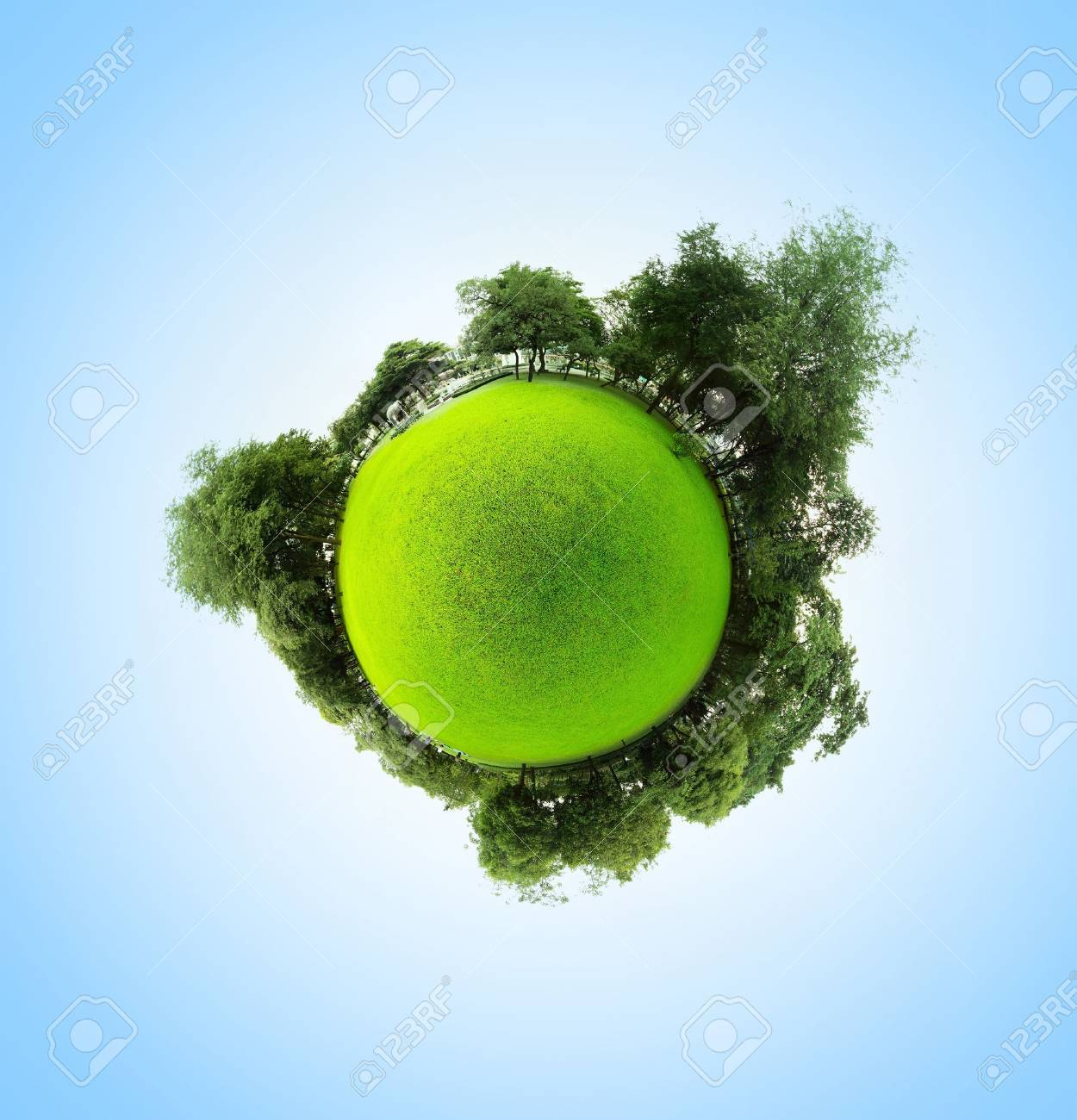 Green little planet with trees meadow and clear sky Stock Photo - 16875496