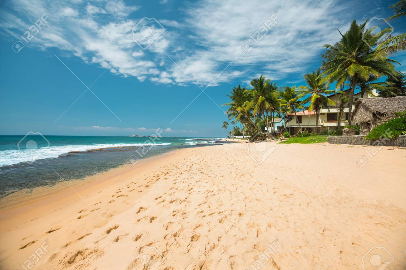 Tropical Sandy Beach With Palm Trees At Sunny Day South Of Bali