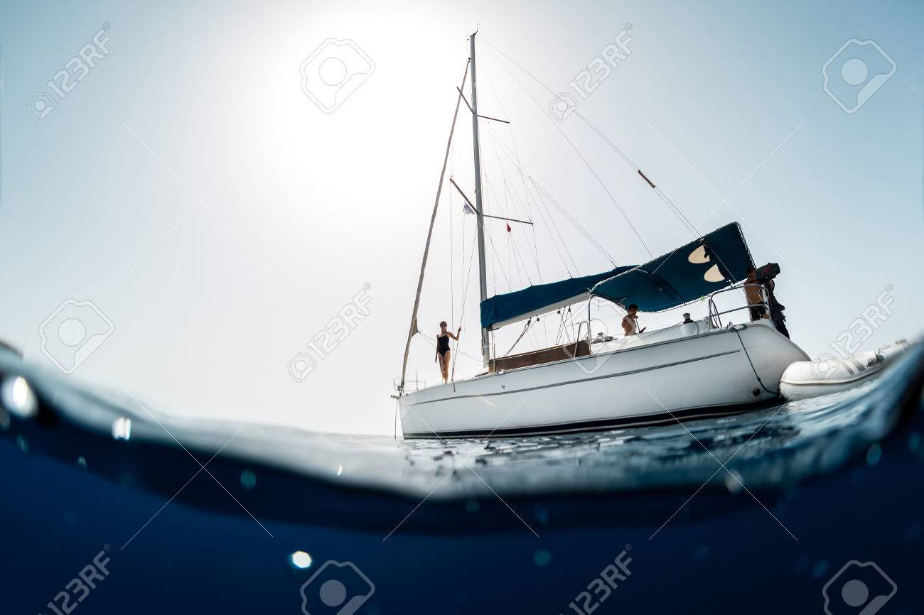Young people on a yacht at sea - 58837878