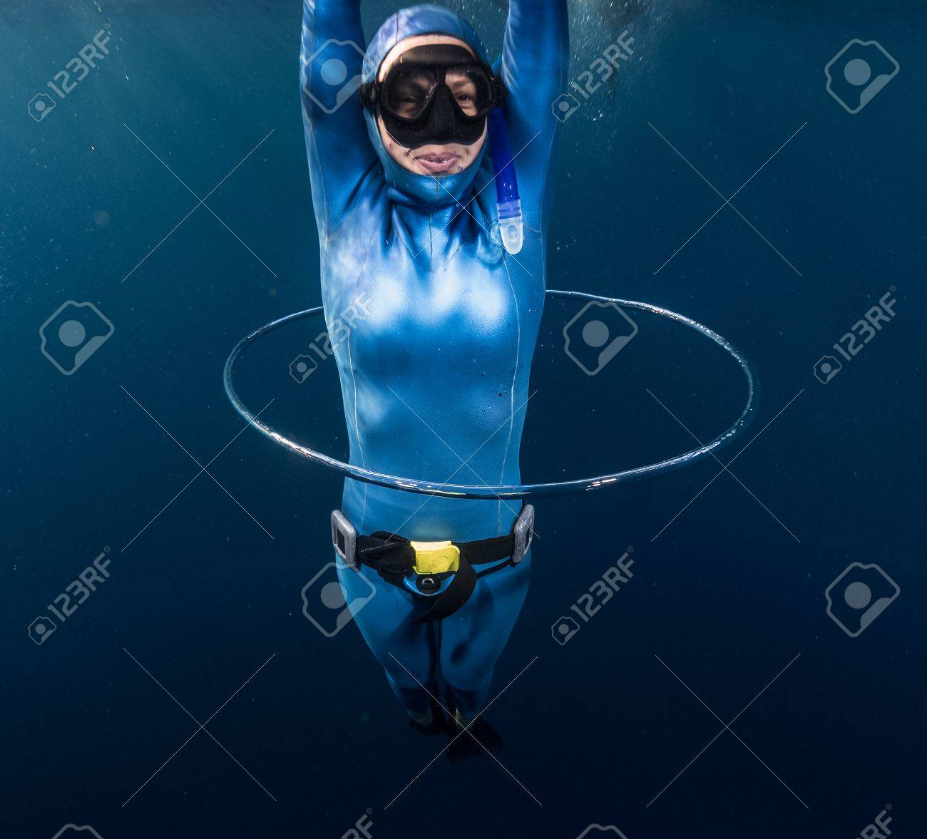 woman free diver having fun with bubble ring stock photo picture