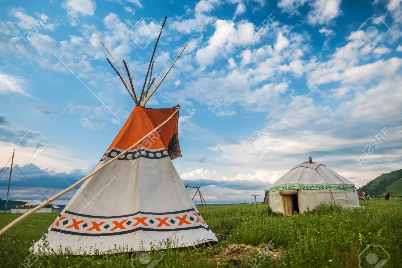 sports shoes 83209 9b52a Teepee and yurt set on the green meadow with blue sky on the..