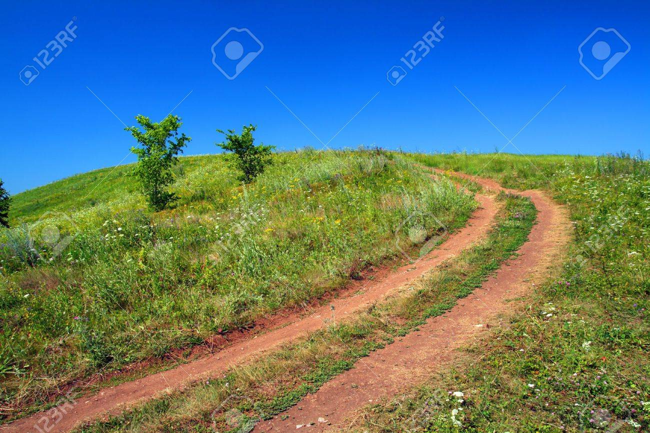 rural road uphill on green field Stock Photo - 3369515