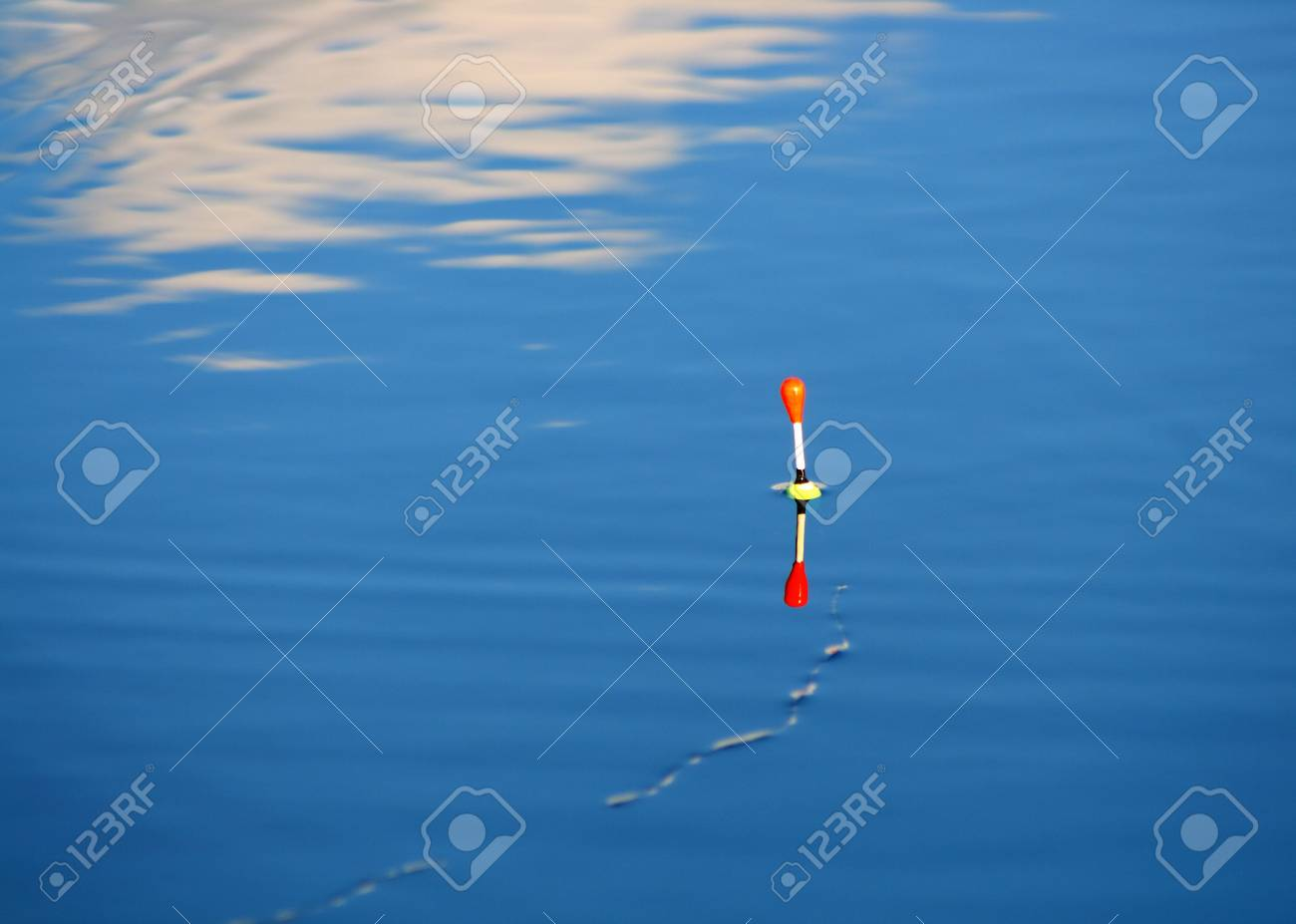 float on ripple blue water of lake Stock Photo - 5642053