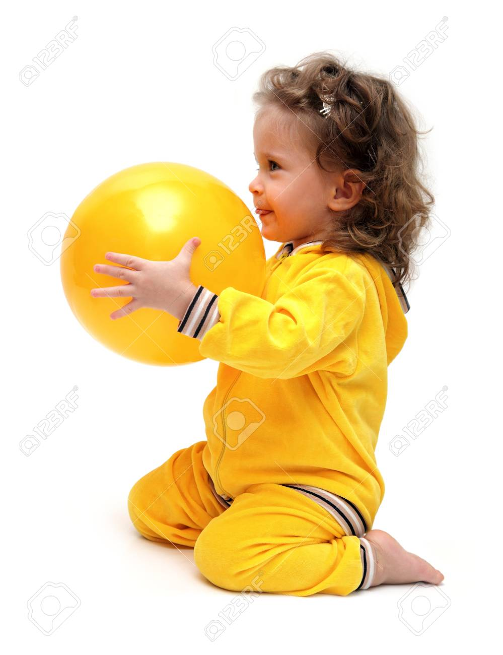 cute little girl in yellow playing with ball - 9095966