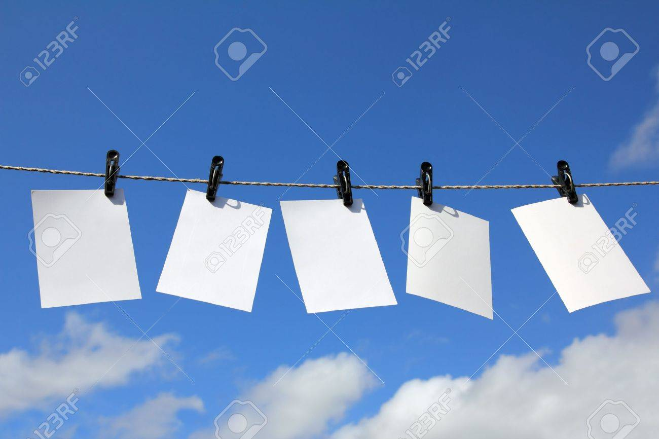 blank photos are hanging against blue sky - 10627658
