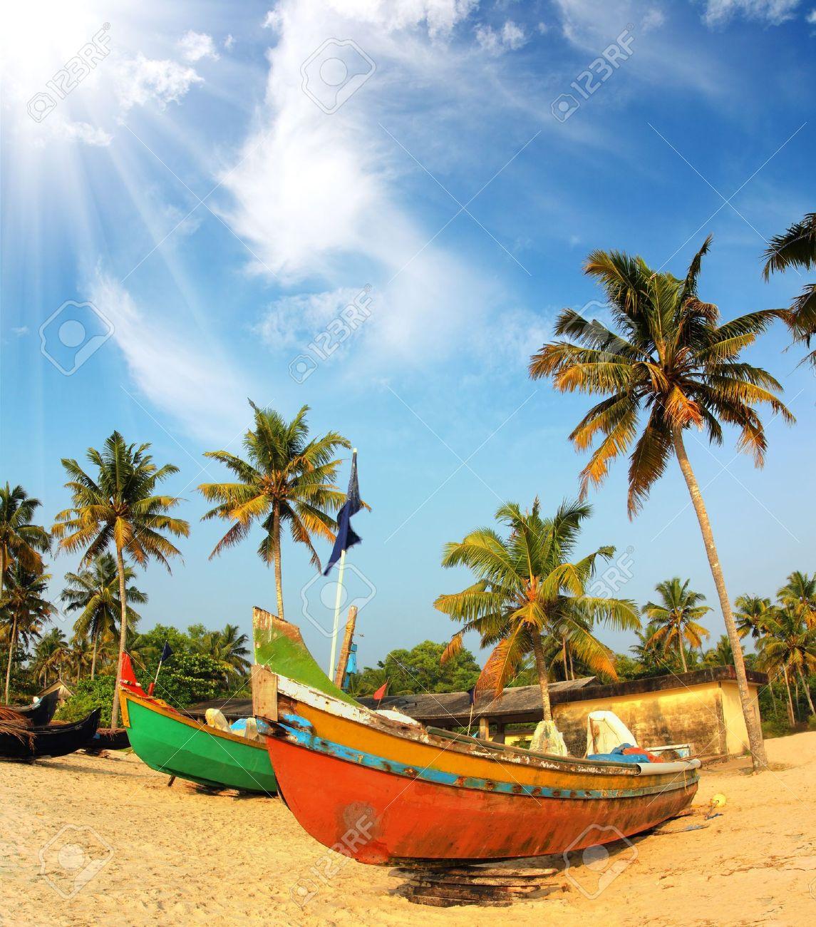 old fishing boats on beach - kerala india - 19933245