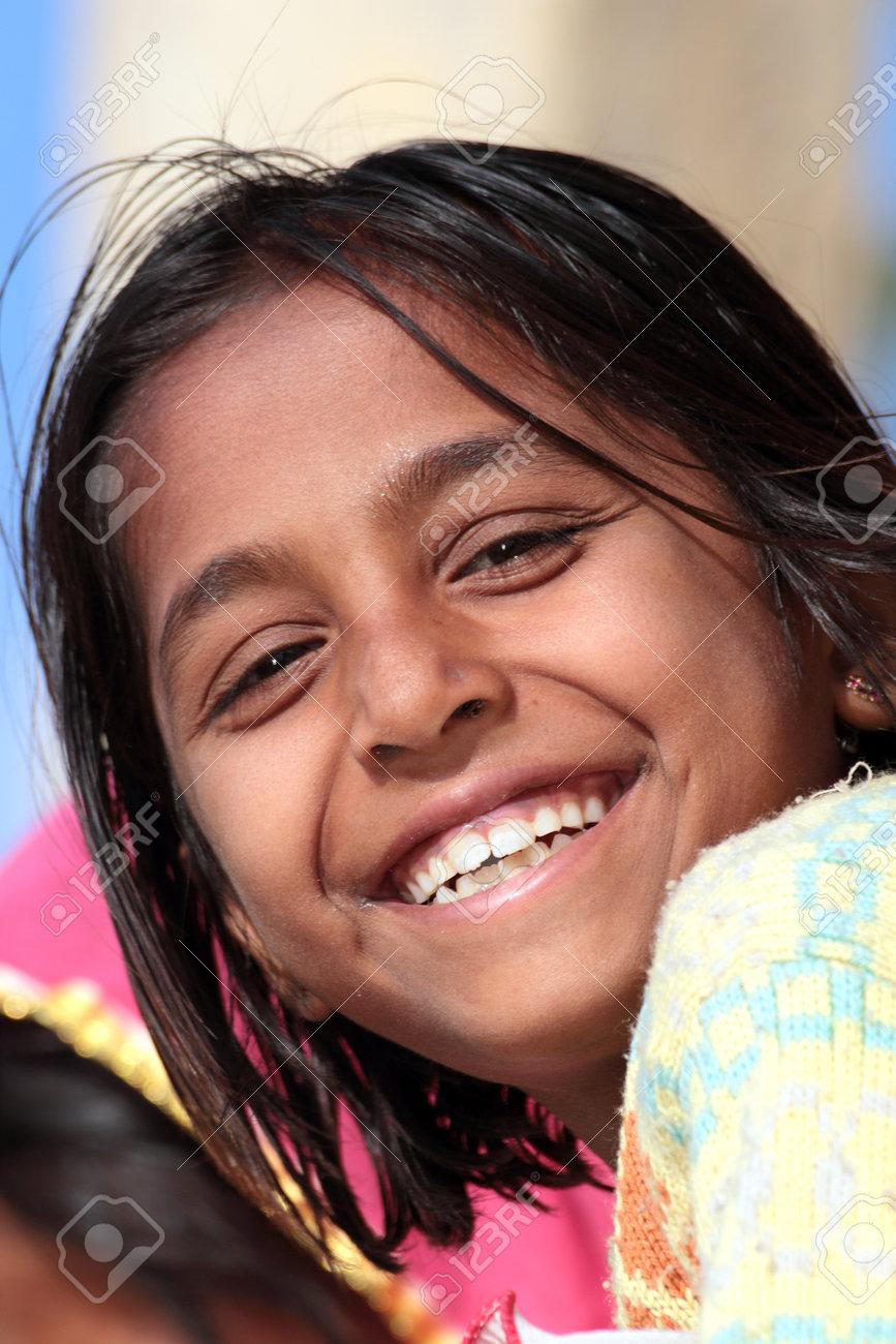 JAISALMER, INDIA - NOVEMBER 28, 2012: Portrait of happy village indian girl - 25486048