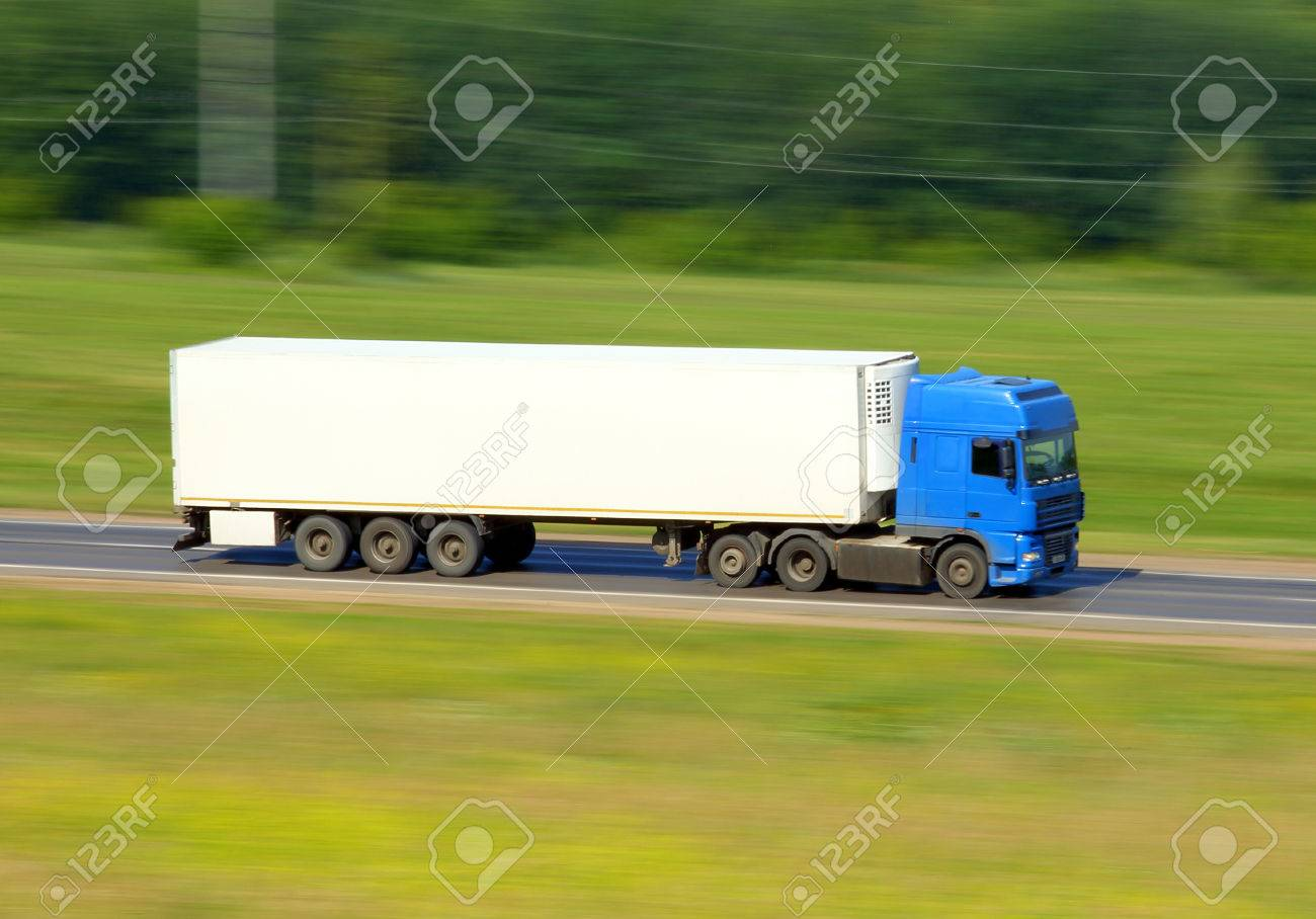 truck driving on a road - slow shutter - 30487494