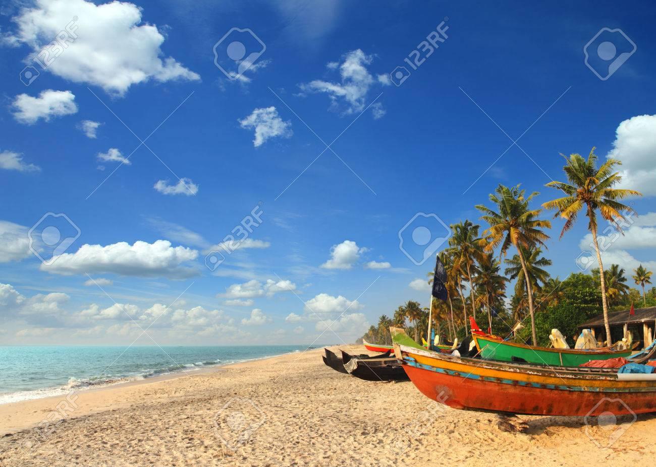 old fishing boats on beach - kerala india - 31320362