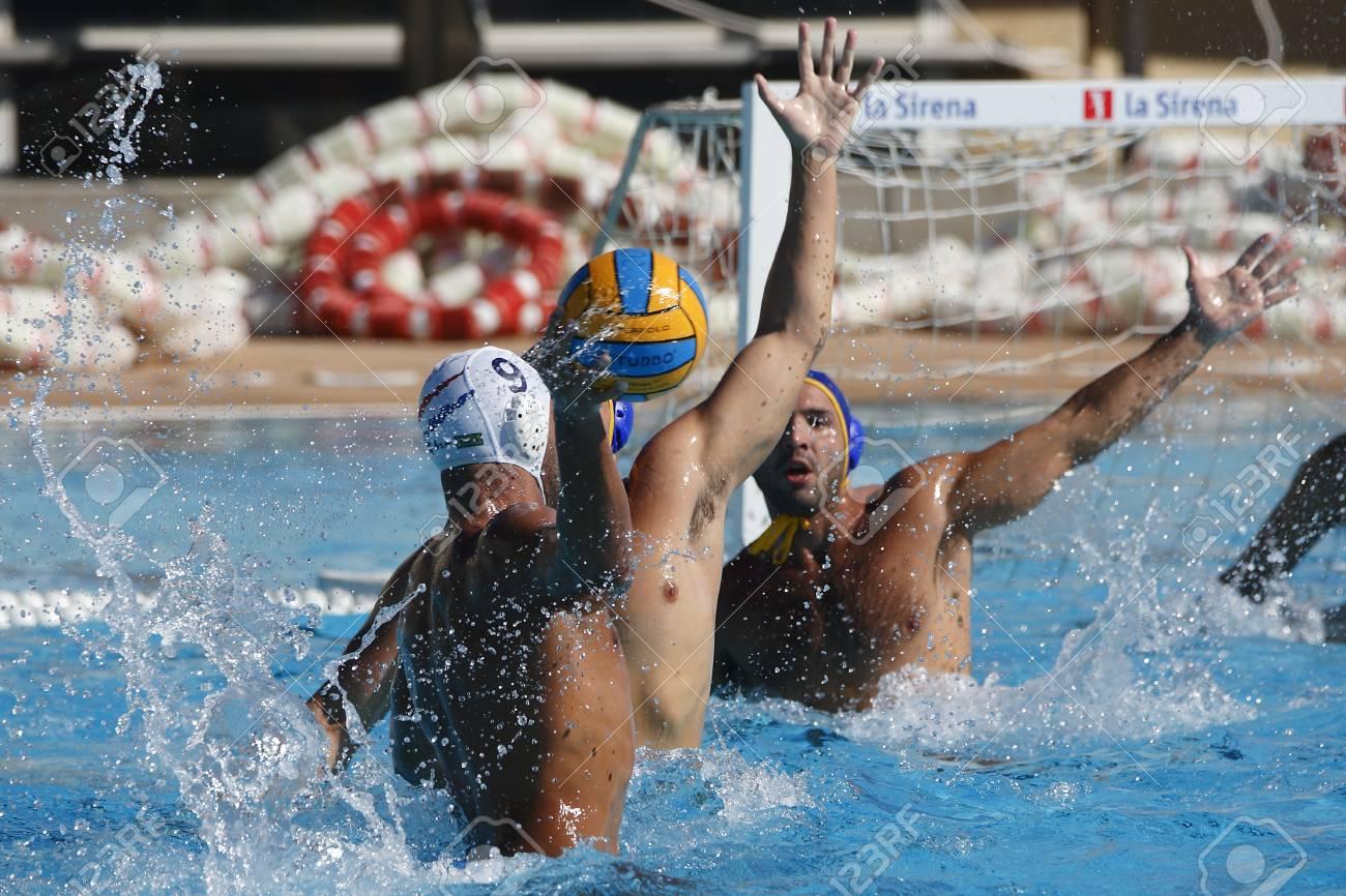 Waterpolo competition. CN Mataro VS Barceloneta. Mataro, Spain. October 18, 2014. White cap team Mataro. Blue cap team Barceloneta - 32668327