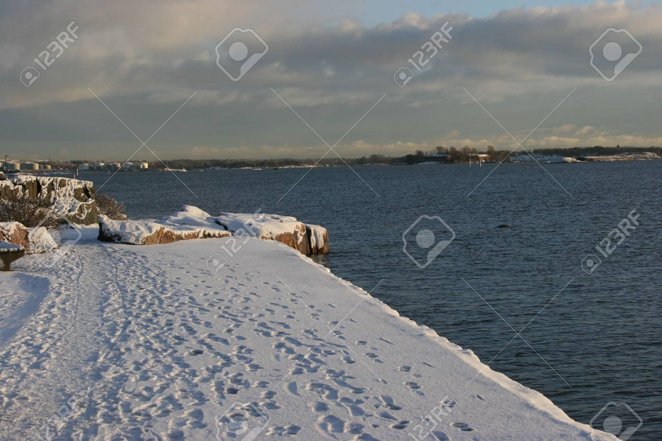 We Still Have Lot Of Snow On Ground But >> Snowy Ground But Sea Is Not Frozen And Footsteps On Snow Stock Photo
