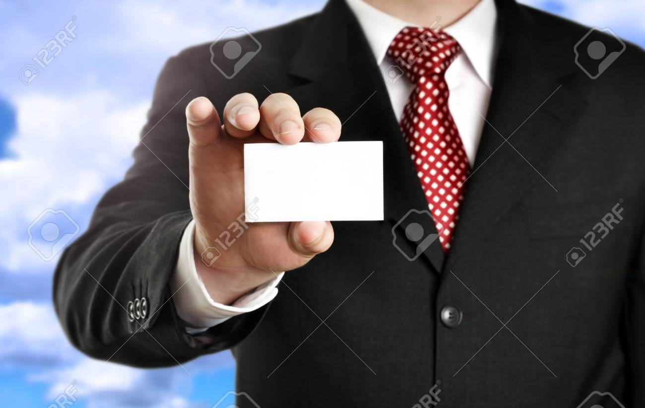 Businessman showing his business card, focus on fingers and card. Stock Photo - 3574786