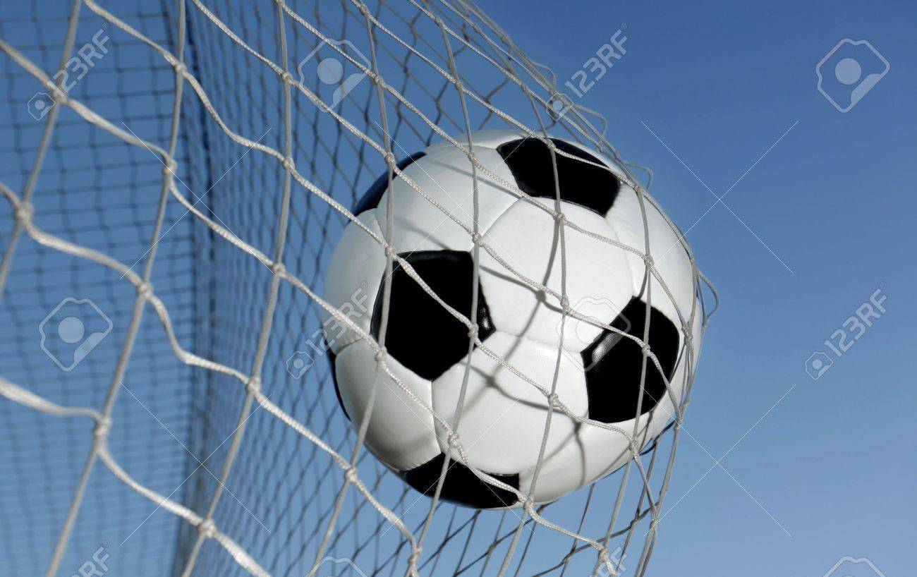Soccer ball kicked into the back of a goal Stock Photo - 5576239