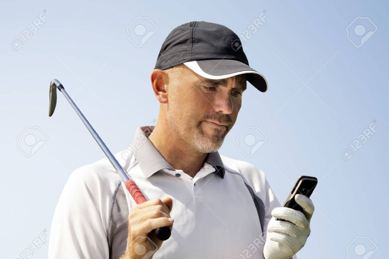 Golfer using mobile phone Stock Photo - 9871241