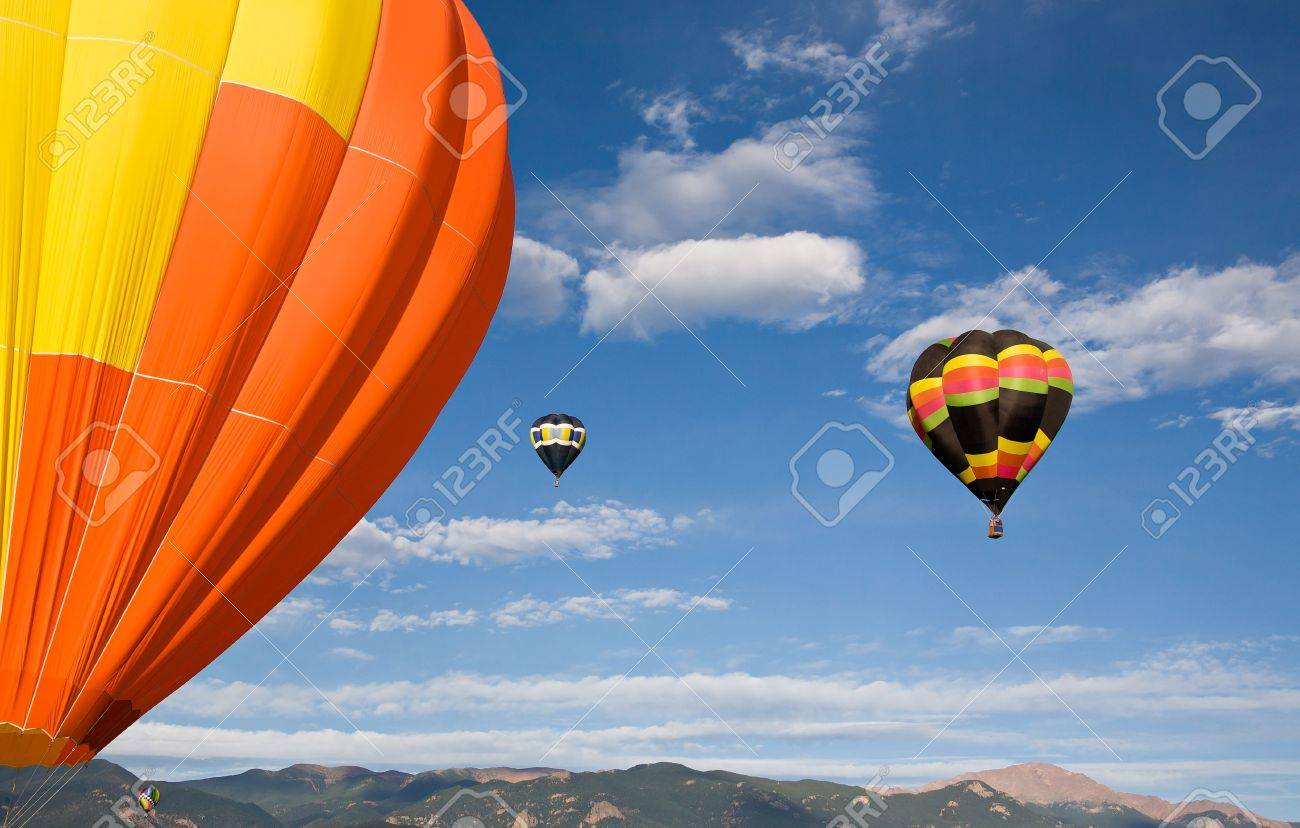 Balloons inflate and ascend into the sky over Pikes Peak. Stock Photo - 7758751