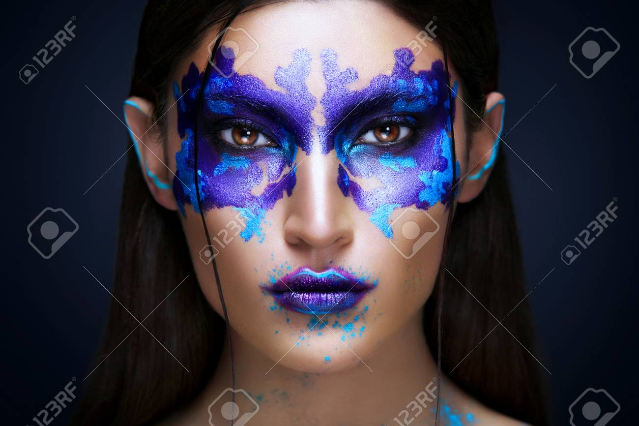 Beauty portrait of the girl with Rorschach test on her face