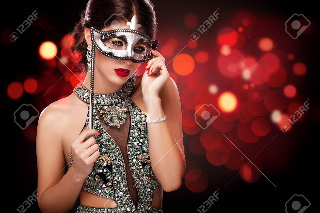 67a42c0727ee Beauty model woman wearing venetian masquerade carnival mask at party over  holiday dark background. St