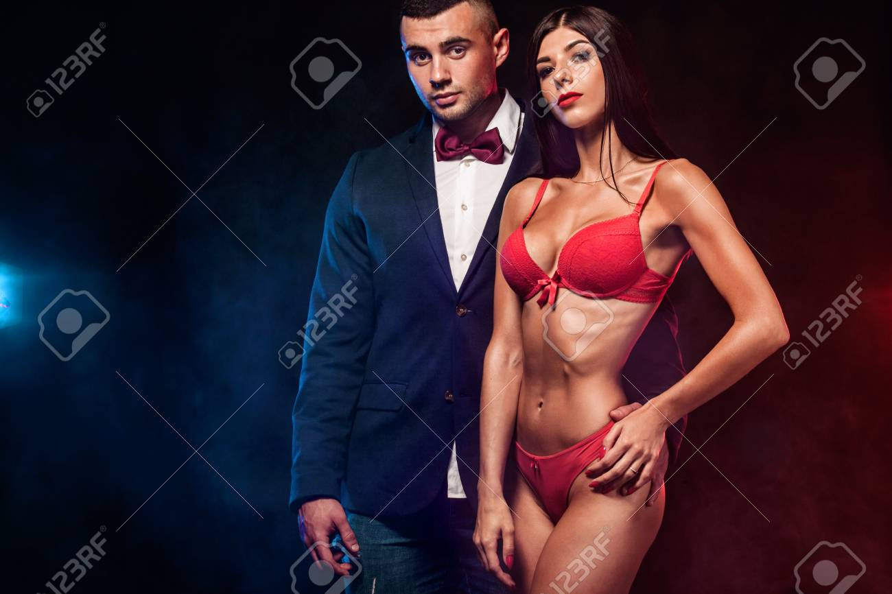 b7939cb1d Portrait of sexy and fit woman wear red lingerie and hugging handsome  fitness man in black