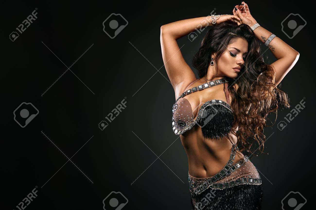 Portrait of beautiful woman, traditional ballydance dancer. Ethnic dance. Belly dancing. Tribal dancing. - 118853895