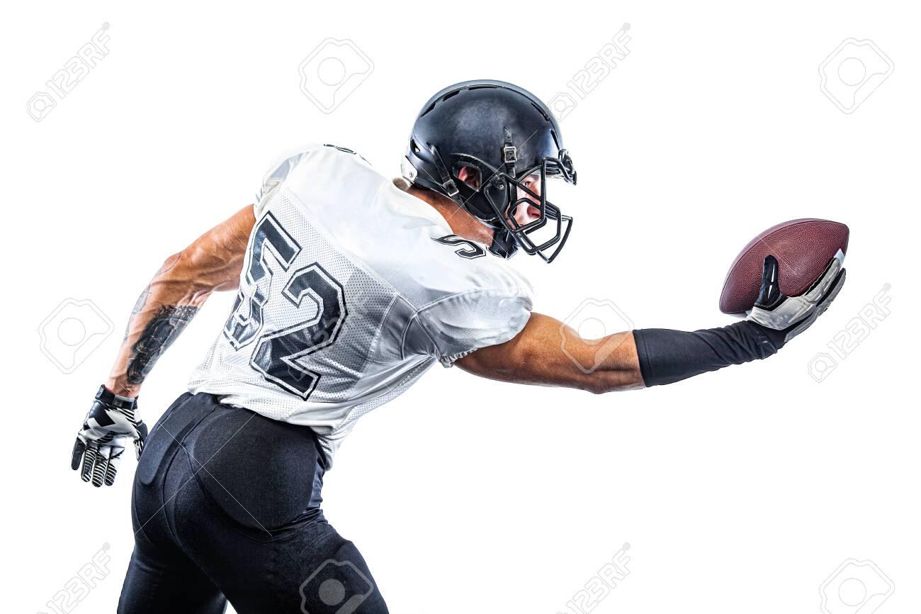 American Football player on stadium with smoke and lights. - 137002156