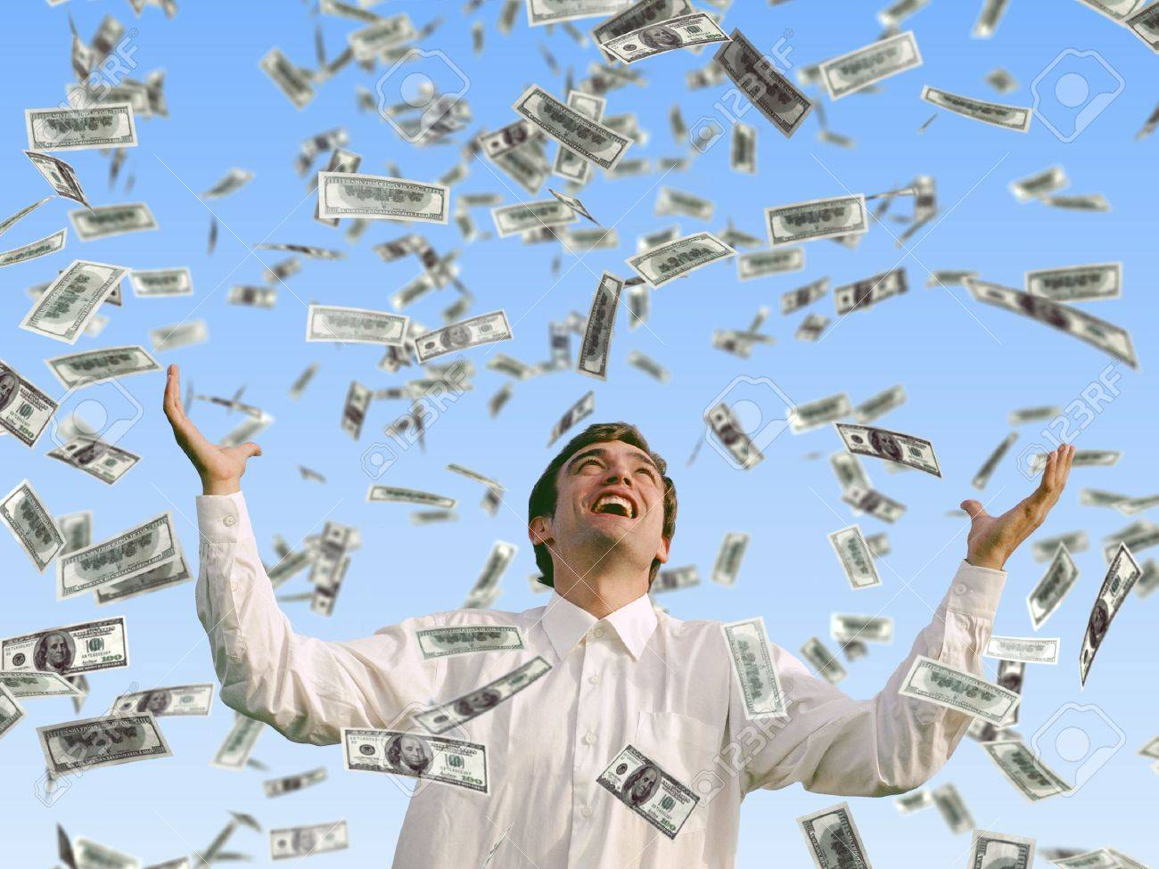 man catching falling dollars Stock Photo - 11545400