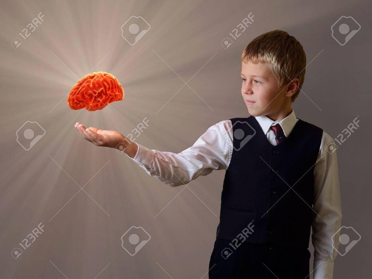 glowing brain of the child hand - 15603772