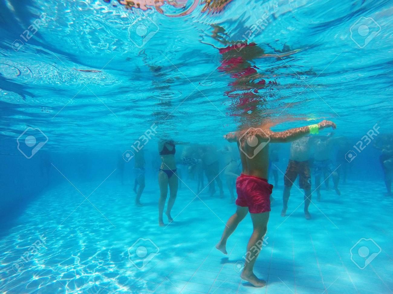 aqua aerobics in the pool - 60570924