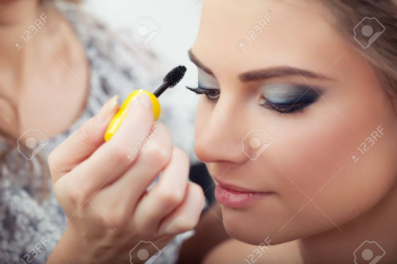 Make Up Artist Applying Mascara On Model S Eyelashes Close Up