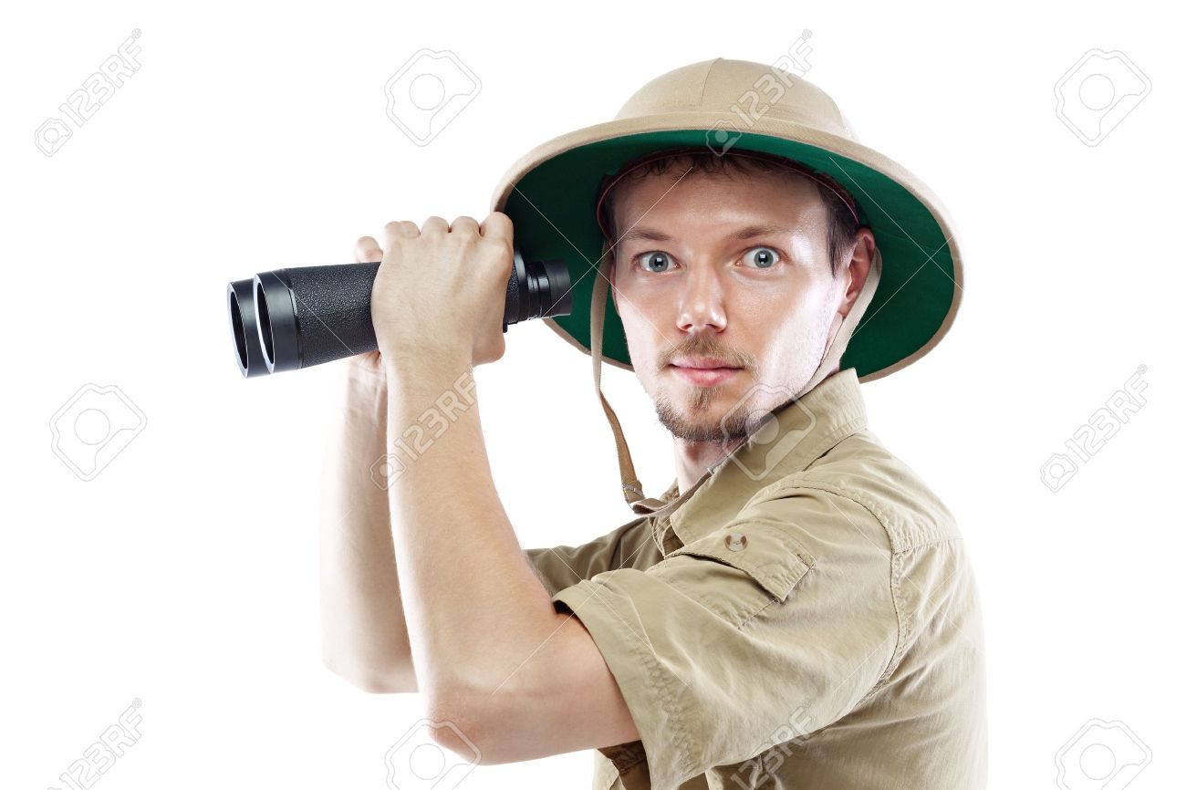 Young man wearing safari shirt and pith helmet holding binoculars, isolated on white background, side view Stock Photo - 17394662
