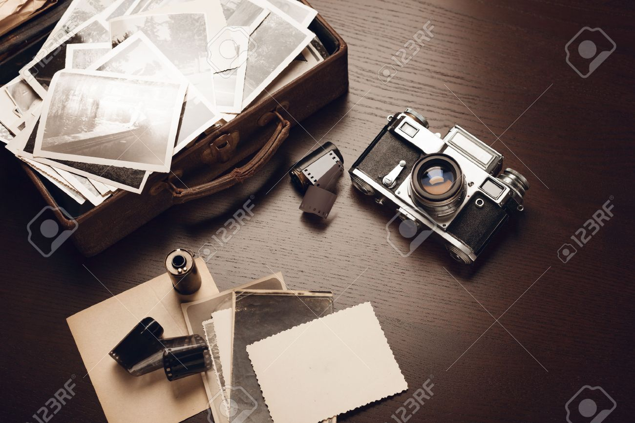Case with old black and white photographs, film camera and film reels; blank card on foreground (all photos are mine) - 52107433