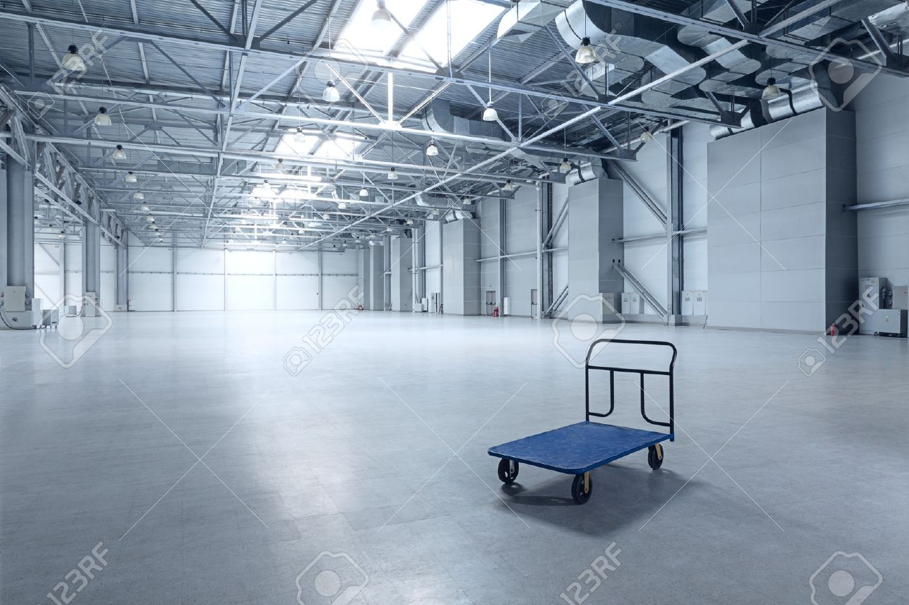 Interior of empty warehouse with a cart - 54640333