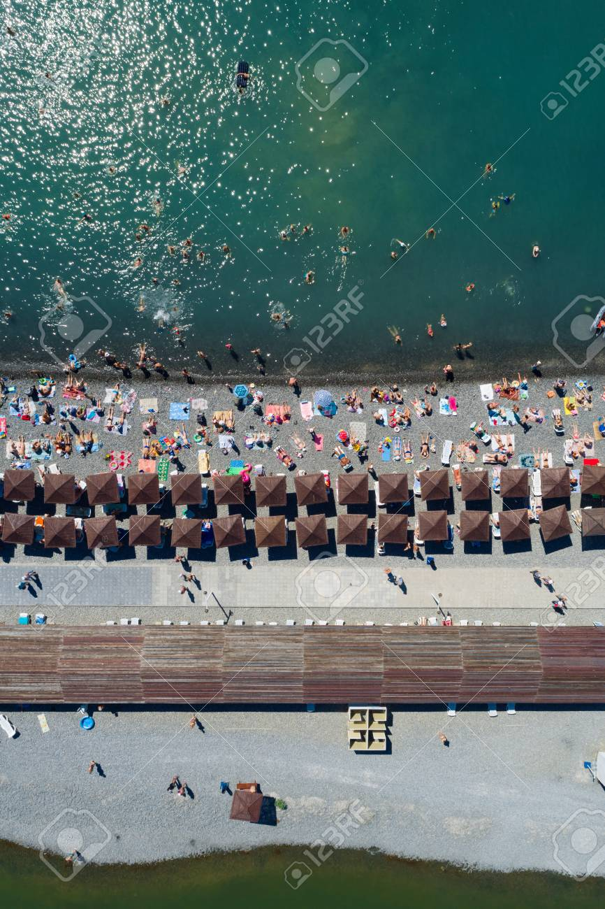 Top Aerial View Of The Pebble Beach Rows Of Umbrellas And Sunbeds