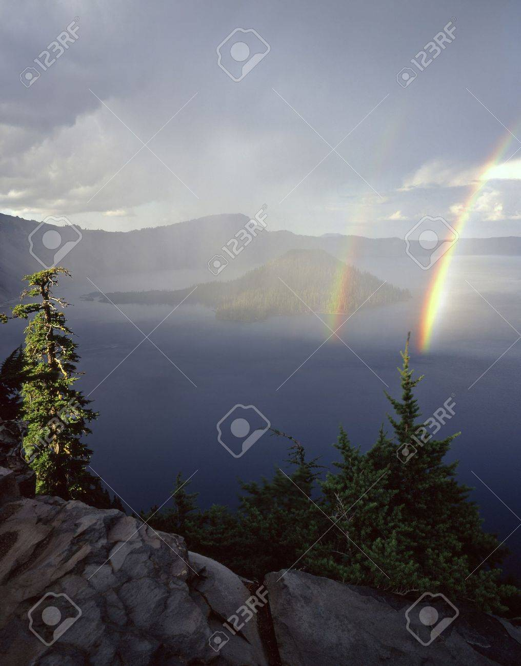 Double rainbows over Wizard Island and Crater Lake in Crater Lake National Park, Oregon. Stock Photo - 777661