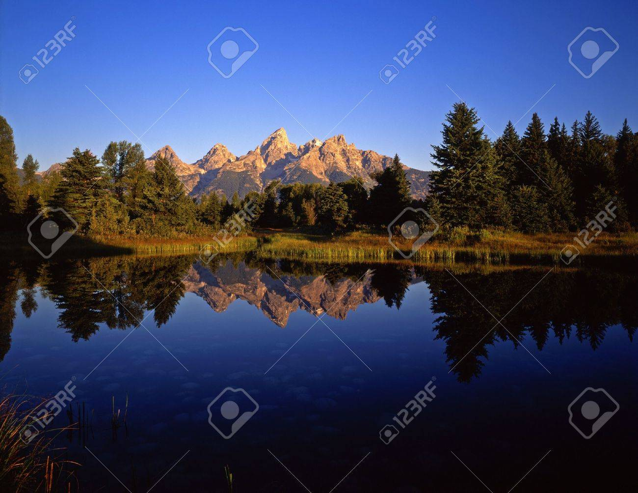 The Teton Range reflecting in the Snake River, at Schwabachers Landing, in Grand Teton National Park, Wyoming. Stock Photo - 777644